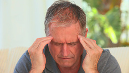 Mature man having a huge headache Footage
