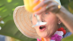Beautiful aged woman celebrating Footage