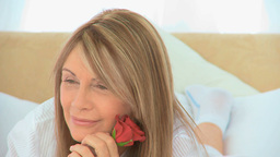 Mature woman holding a rose Stock Video Footage