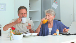 Cute mature couple taking a breakfast Footage