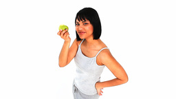 Casual asian woman enjoying an apple Stock Video Footage