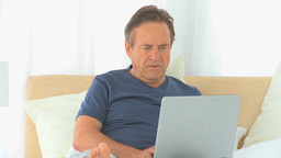 Mature man focus on his laptop Footage