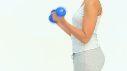 Woman doing exercise with dumbbells Footage