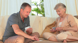 Elderly woman winning against her husband Stock Video Footage