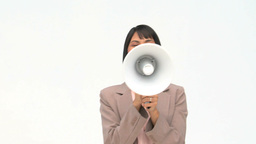 Chinese business woman shouting through a loudspeaker Footage