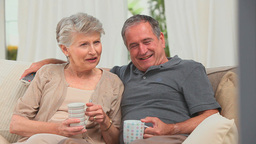 Mature couple watching tv Footage