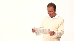 Retired man reading a newspaper Footage