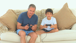 A grandfather playing video games Stock Video Footage