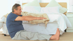 Retired man stretching himself Footage