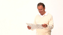 A man reading a newspaper Footage