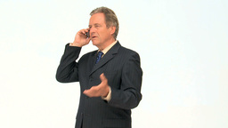 Elderly businessman having a phone call Footage