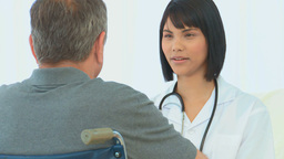 Nurse talking with her patient Footage