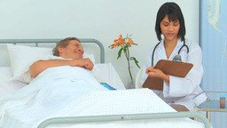A nurse giving results to her patient Stock Video Footage