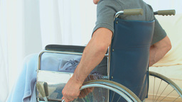 Man in a wheelchair thinking Stock Video Footage