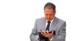 Elderly businessman taking notes Footage