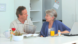 Mature couple talking during the morning Stock Video Footage
