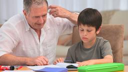 Little boy doing his maths homeworks Footage