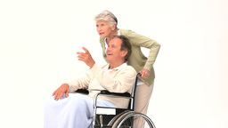 A man in wheelchair talking with his wife Footage