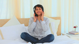 Casual asian lady listening to music Stock Video Footage