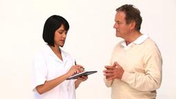 A nurse giving prescriptions to her patient Footage