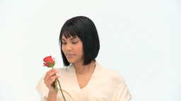 A cute chinese woman holding a flower Footage