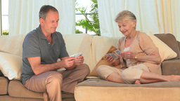 Elderly couple playing cards Stock Video Footage