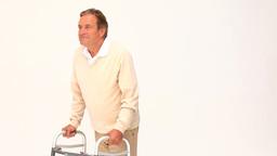 Retired man using a walker Footage