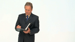 Mature businessman taking notes Footage