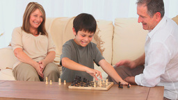 Little boy playing chess Stock Video Footage