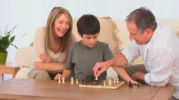 Little boy playing chess Footage