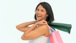 Asian woman holding shopping bags Footage