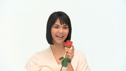 Asian woman holding a red rose Stock Video Footage