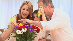 Family putting on flowers in a vase Stock Video Footage