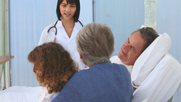 A Family And Nurse At The Hospital stock footage