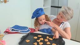 Cute curlyhaired girl eating cookies Stock Video Footage