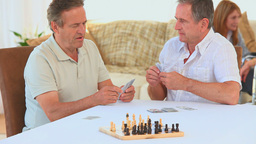 Elderly friends playing cards Footage