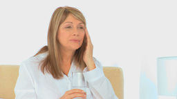 A sick woman with a glass of water Stock Video Footage