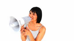 Asian woman shouting through a megaphone Footage