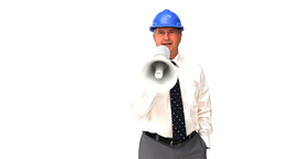 An mature architect shouting through a loudspeaker Stock Video Footage