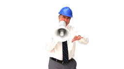 An mature architect shouting through a loudspeaker Footage