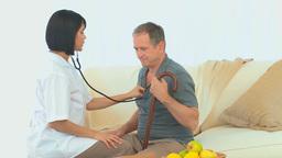 Asian nurse listening to heartbeat Footage