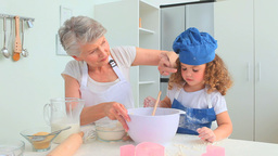 Cute curly haired girl baking Stock Video Footage