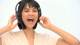 Cute asian woman listening to music Footage