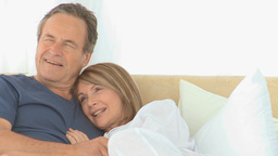 Lovely couple on their bed Stock Video Footage