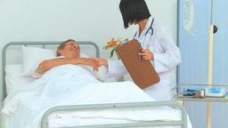 Elderly man receiving a visit of his nurse Footage