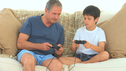A grandson giving explanations to his grandfather Footage