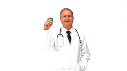 Mature doctor holding yellow pills Stock Video Footage
