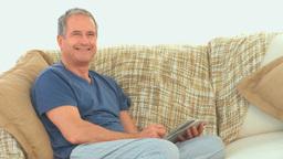 Retired man doing cross words Footage