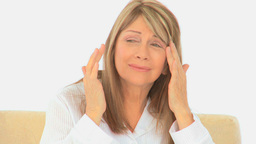 Elderly woman having a huge headache Stock Video Footage