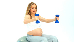 Pregnant lady with dumbbells Footage